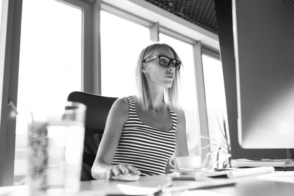 black and white image of working woman